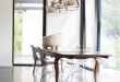 love the mix of industrial / modern with traditional dining table .