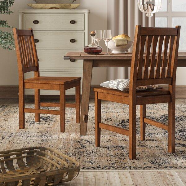 Loon Peak® Fort Kent Slat Back Side Dining Chair in Medium Oak .