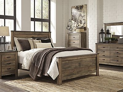 Trinell 5-pc. Queen Bedroom Set - Replicated oak grain takes the .