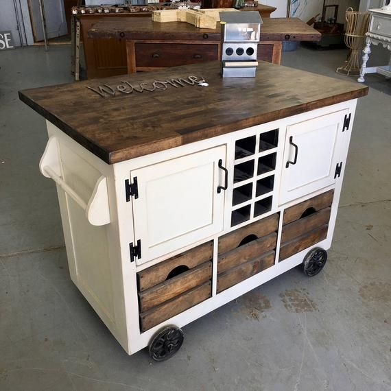 Small industrial style kitchen island with plenty of storage space .