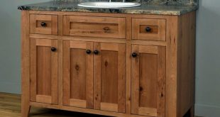 Shaker style bathroom vanity cabinet made of Rustic Cherry .